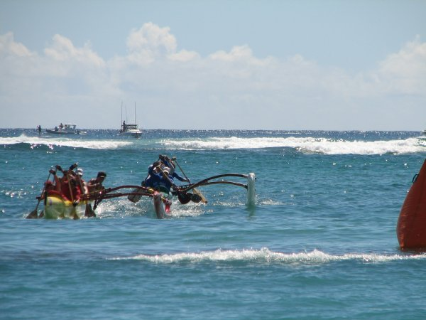 Two teams paddle fiercely for the finish line